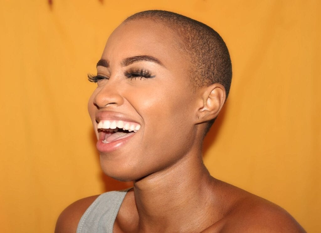 Smiling, white teeth, Photo by Kim Carpenter, Unsplash