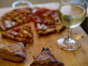 Pizza and wine. Photo by Brett Jordan, Unsplash