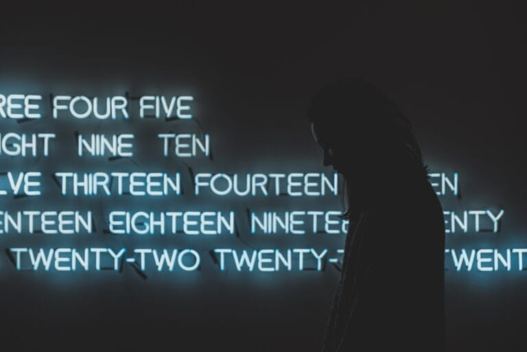 Numbers, silhouette of woman, photo by lnur Kalimullin on Unsplash