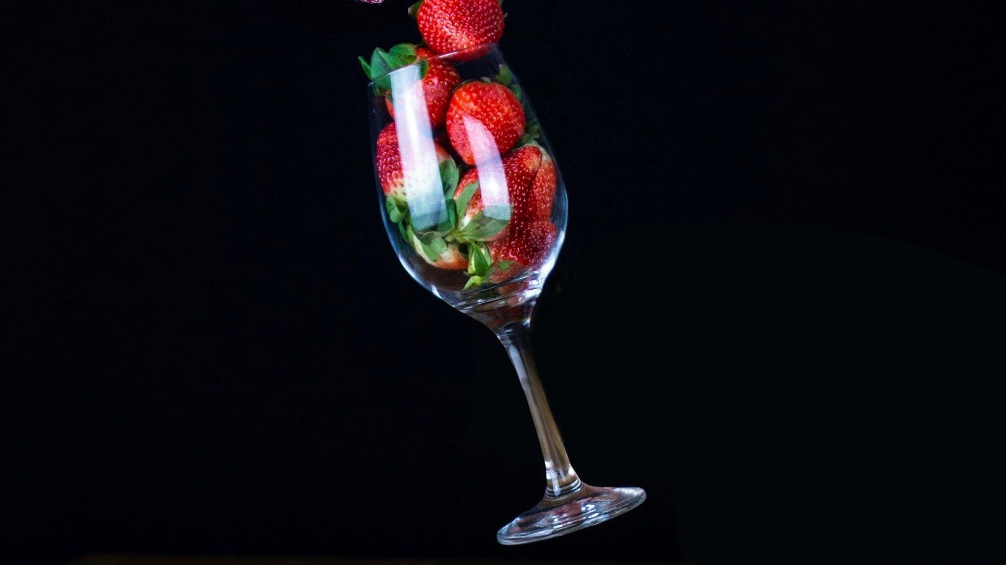 Wine glass with strawberries. Photo by Yulia Matvienko, Unsplash