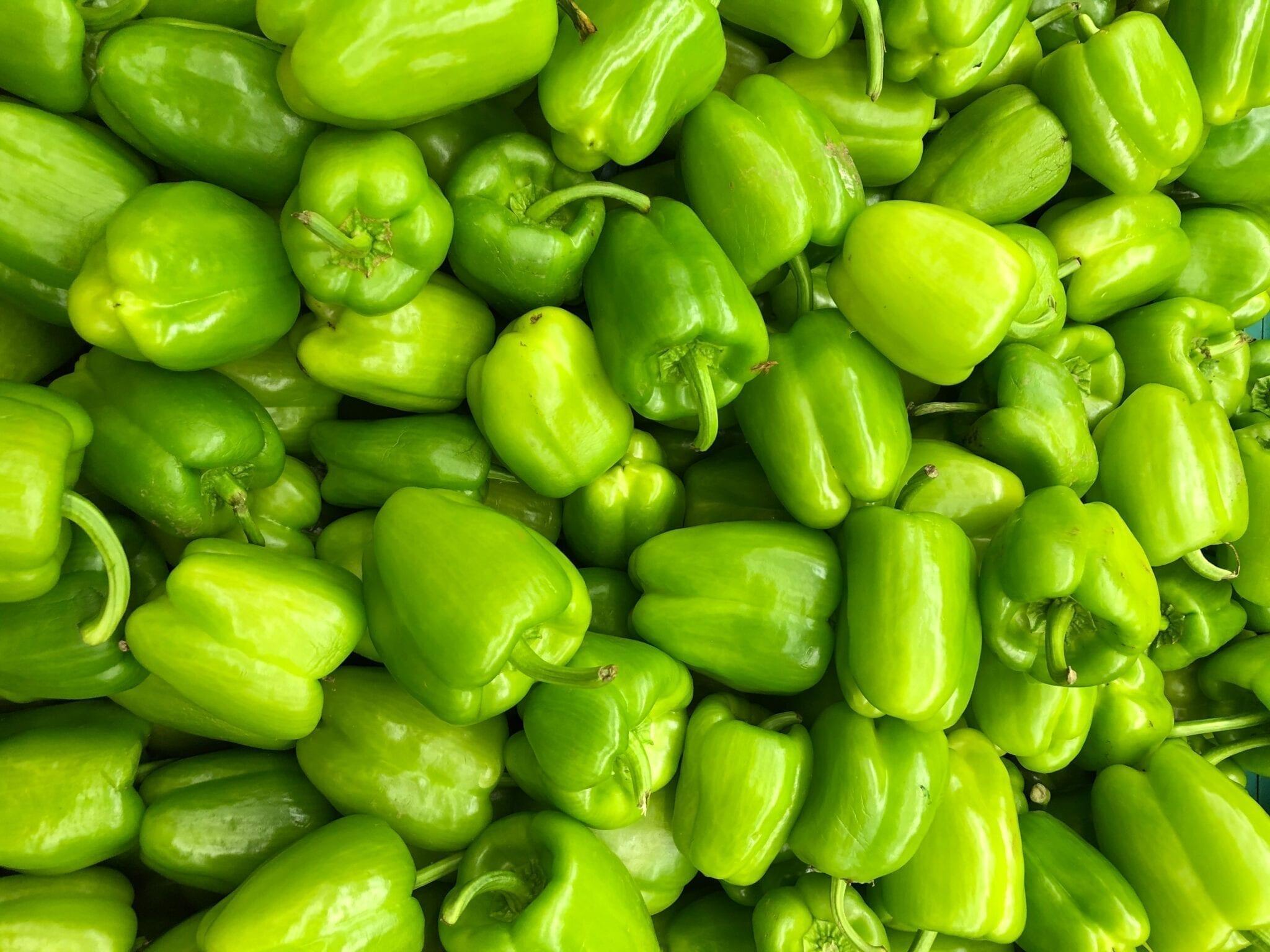 Green bell peppers. Photo by Alli Stefanova, Unsplash